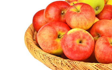 wattled: Red apple in a wattled basket, isolated on white background