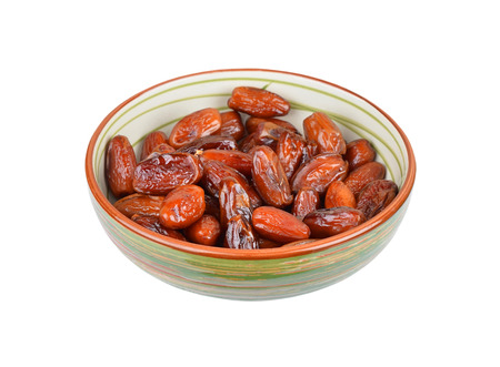 date fruit: Delicious dried date fruit in bowl, isolated on white