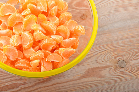 cantle: Mandarin in glass bowl on wooden background