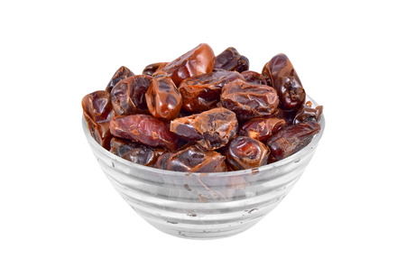 date fruit: Delicious dried date fruit in glass bowl, isolated on white