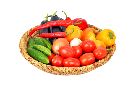 wattled: Vegetables in a wattled basket, isolated on white background