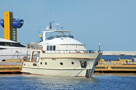 odessa: White motor yacht over harbor pier, Odessa, Ukraine