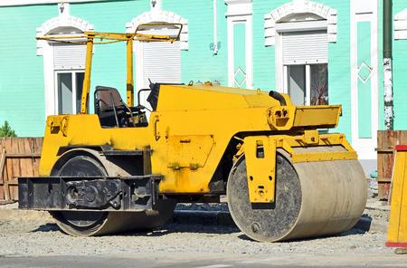 paver: Asphalt paver on road construction site