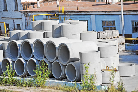 produce departments: Concrete circle pit and pipe block on factory yard