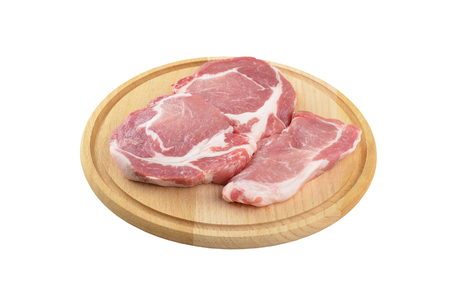 flesh eating animal: Raw meat steaks on wooden board, isolated on white background Stock Photo