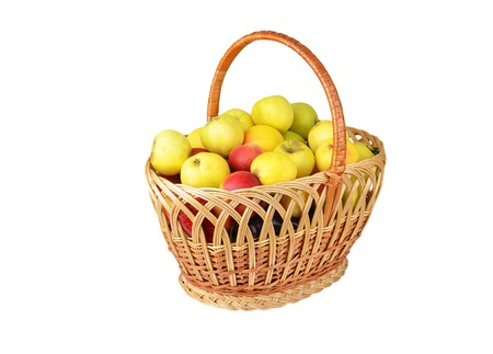 wattled: Apple in a wattled basket, isolated on white background