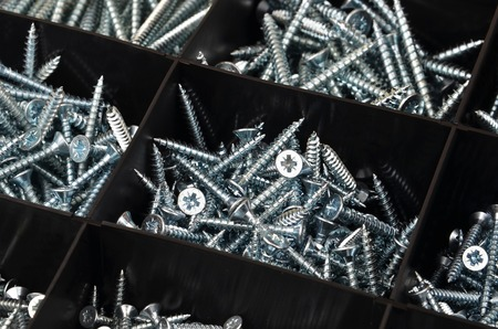 inflexible: Screw in black plastic organizer box, DOF Stock Photo