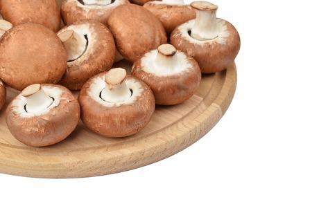 true: Champignon (True mushroom) on wooden board, isolated on white background