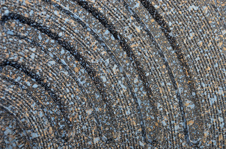 spotted: Black spotted textured  metallic background, close up