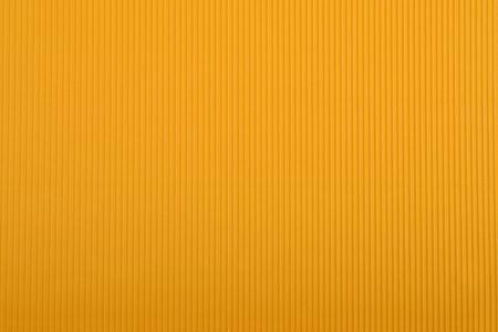 Close up of orange crinkled cardboard background
