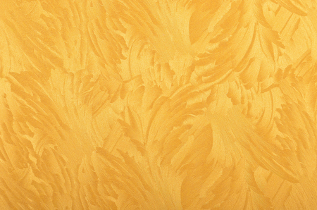 Glittery and textured golden metallic paper background
