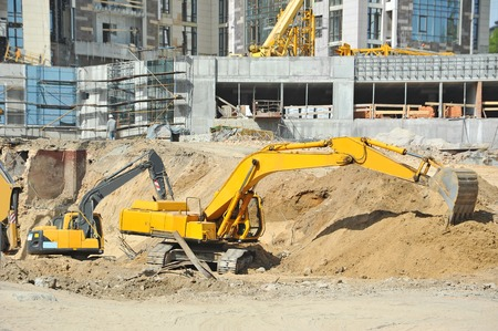 excavating: Work of excavating machine on building construction site Stock Photo