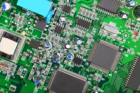microcircuit: Green printed computer motherboard with microcircuit, close-up