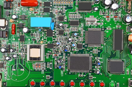 cmos: Green printed computer motherboard with microcircuit, close-up