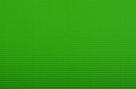 utilize: Close up of green crinkled cardboard background