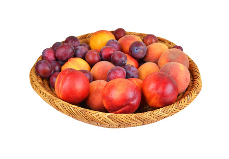 Fruits in wattled basket, isolated on a white background