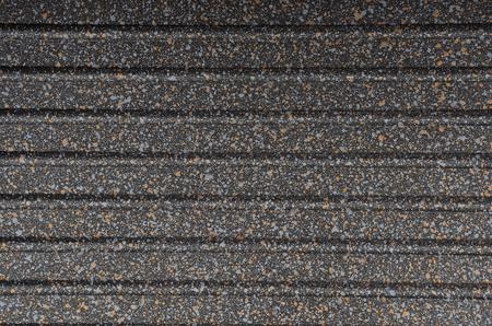 black metallic background: Black spotted textured  metallic background, close up