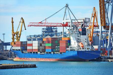 Container stack and cargo ship under crane bridge