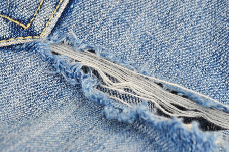 vamp: Torn blue jeans background, close up, DOF Stock Photo