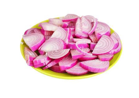 poignant: Slised red onion on plate, isolated on white background