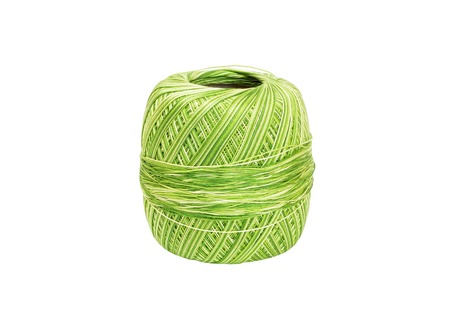 sartorial: Skein of green wool, isolated on a white background