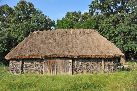 Ancient traditional ukrainian rural wooden barn Stock Photo