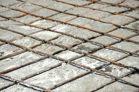 waterproofing material: Rusty steel armature and concrete on construction site