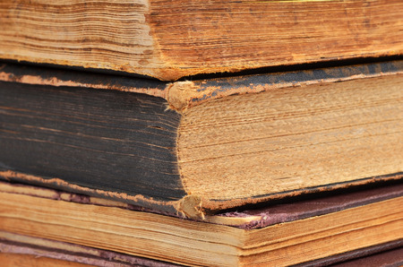 hard cover: Dirty antique hard cover book, close up, DOF