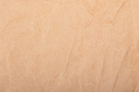 Wrinkled packaging paper background, close up, DOF