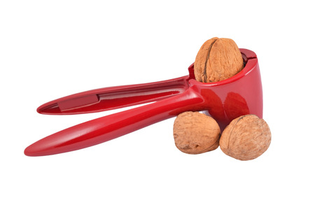 Nutcracker and nut, isolated on white background Stock Photo