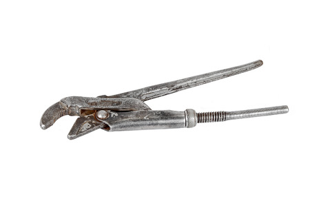 screw key: Old rusty adjustable wrench, isolated on white background