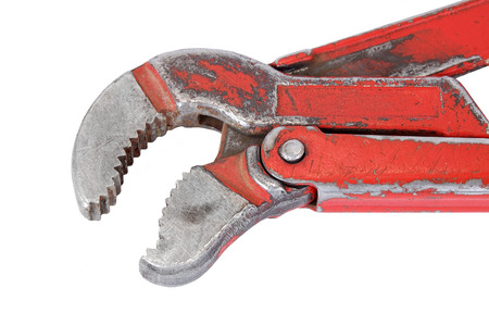 Old rusty adjustable wrench, isolated on white background
