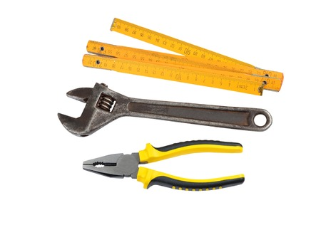 handtools: Meter, wrench and pliers, isolated on white background
