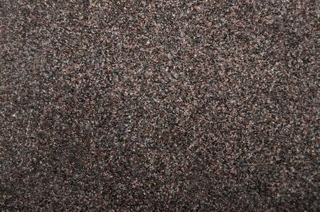 specular: Rough vintage textured sandpaper background, close up