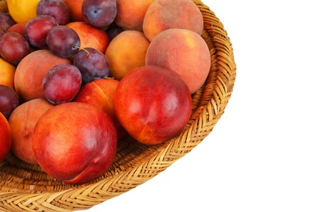 wattled: Fruits in wattled basket, isolated on a white background