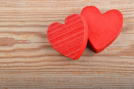 Red heart on wooden background, card for Valentines day