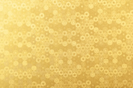 glittery: Glittery and textured golden metallic paper background