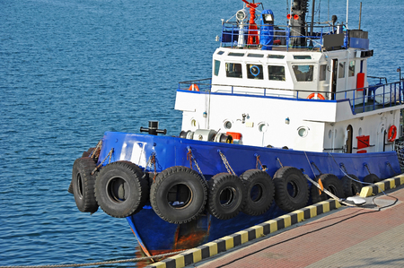 Tugboat in harbor quayside on Odessa, Ukraine