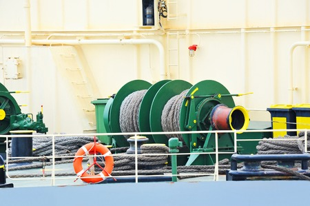Mooring winch mechanism with hawser on ship deck Stock Photo