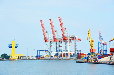 Port cargo crane and container over blue sky background