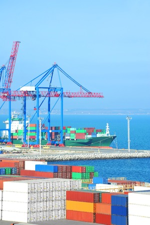 Port cargo crane, ship and container over blue sky background Stock Photo
