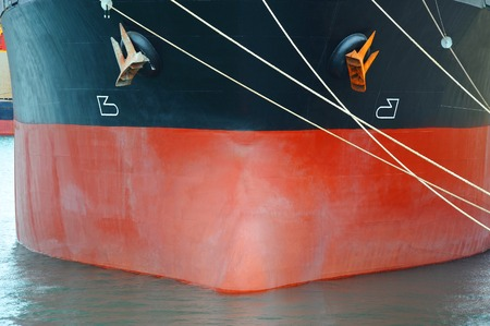 Bulk carrier: Bulk carrier ship bow with mooring rope Stock Photo