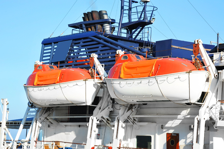 Safety lifeboat on deck of a passenger ship Stock Photo
