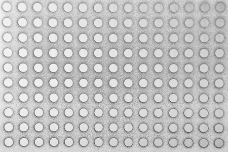 stell: Perforated textured stell metallic background, close up Stock Photo