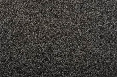 specular: Vintage textured sandpaper background, close up