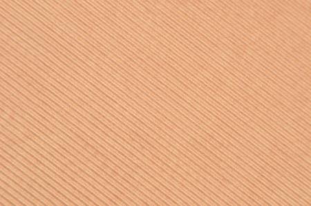 Close up of beige crinkled cardboard background