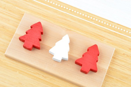 Decorative Christmas fir tree on natural wooden background Stock Photo