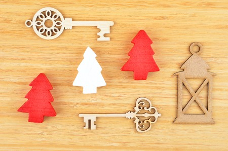ramification: Christmas tree and decor on natural wooden background