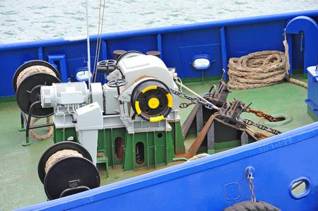 navy pier: Anchor windlass mechanism with chain on ship deck