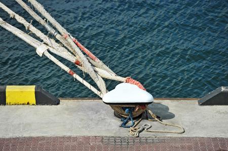 mooring bollard: Old mooring bollard in port Odessa, Ukraine Stock Photo